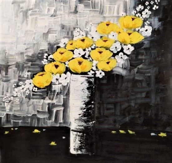 yellow flower in vase
